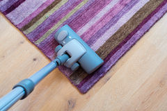 Spring cleaning - vacuum cleaner to tidy up Stock Photo