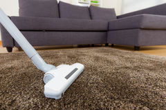 Vacuum cleaner using in living room Royalty Free Stock Photography