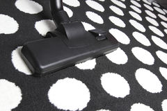 Vacuum cleaner on White dot carpet Royalty Free Stock Photography