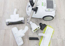 Vacuum Cleaner. On a white wooden floor stock photography