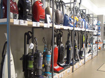Vacuum cleaners or hoovers for sale in a store. royalty free stock photo