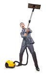Vacuum cleaning by businessman Royalty Free Stock Images