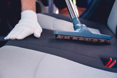Vacuum cleaning car seats Royalty Free Stock Photo