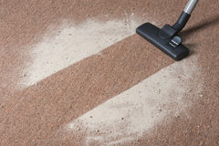 Vacuum cleaning carpet Royalty Free Stock Image