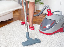 Vacuum cleaning carpet Royalty Free Stock Photography