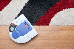 Vacuum cleaning robot working Royalty Free Stock Photo