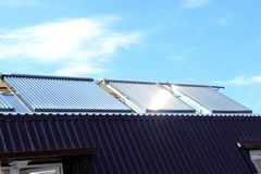 Vacuum solar water heating system on the house roof. Vacuum collectors- solar water heating system on roof of the house stock photography
