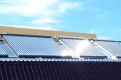 Vacuum solar water heating system on the house roof. Vacuum collectors- solar water heating system on roof of the house stock image