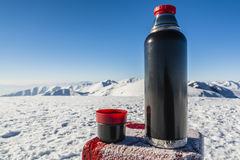 Vacuum flask of hot tea on a table with a boundary marker in the Stock Images