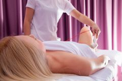 Vacuum massage procedure Royalty Free Stock Images