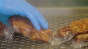 Vacuum Packaging of Processed Meat. Meat industry. Processing of the meat production stock video footage