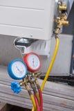 Vacuum pump evacuates air from the air conditioner stock photo