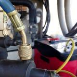 Vacuum pump evacuates and repair air conditioner stock photography