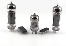 Vacuum radio tubes and semiconductor chips. Over white Stock Photo