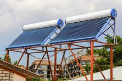 Vacuum solar cells for water heating system on the house roof.  royalty free stock photos