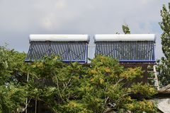 Vacuum solar cells for water heating system on the house roof.  royalty free stock photo