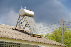 Vacuum solar water heating system on the house roof. Vacuum solar water heating system for house stock photography