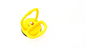 Vacuum sucker with aluminium core in yellow color. Vacuum sucker with aluminium core in yellow plastic color and black rubber isolated Royalty Free Stock Image