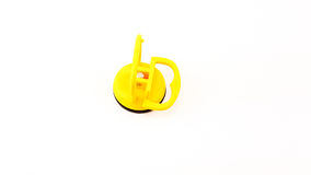 Vacuum sucker with aluminium core in yellow color. Vacuum sucker with aluminium core in yellow plastic color and black rubber isolated Stock Photography