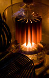 Vacuum tube. Large vacuum tube (valve) power amplifier, tube is glowing red hot Stock Images