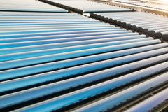 Vacuum tube collectors of solar water heating system. On the roof royalty free stock photo