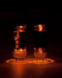 Vacuum tubes. Glowing on a black background Royalty Free Stock Photos