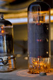 Vacuum Tubes. Glowing in an old radio receiver Stock Photo