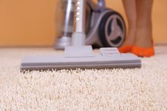 Vacuuming a carpet. Is the best way to keep it clean Royalty Free Stock Image