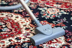 Vacuuming the carpet Royalty Free Stock Photo