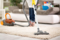 Vacuuming carpet. Close up of vacuuming carpet with vacuum cleaner Stock Photography