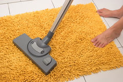 Vacuuming the carpet. Stock Photography