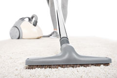 Vacuuming carpet royalty free stock photography