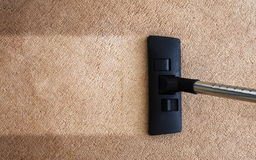 Vacuuming. Closeup of the vacuum on the carpet stock photography
