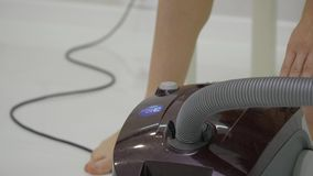 Vacuuming debris on floor parquet. Woman doing cleaning work in house, vacuuming floor in house. close up.  stock video footage