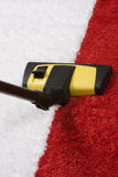 Vacuuming della moquette Fotografie Stock
