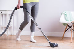 Vacuuming dirty parquet Royalty Free Stock Photo