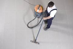 Vacuuming floor with cleaning machine stock photos