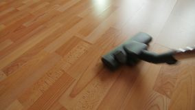 Vacuuming a mess floor. stock footage