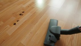 Vacuuming a mess floor. stock video