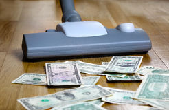 Vacuuming money polish money Royalty Free Stock Photo
