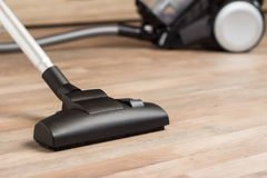 Vacuuming a thick pile white carpet. Vacuuming a thick pile wClose up of the head of a modern vacuum cleaner hite carpet Royalty Free Stock Photography