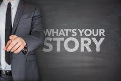 Vad är din berättelse på svart tavla royaltyfria bilder