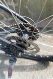 Vada in bicicletta la struttura del frammento della cassetta del disco del freno di ruota posteriore delle parti fotografia stock libera da diritti