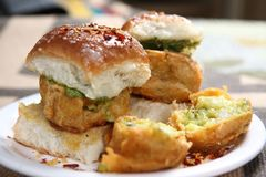 Vada Pav, Indian Burger. The vada is made of a spicy potato filling deep fried in a gram flour batter. Along with a hot and spicy garlic chutney, it is served Royalty Free Stock Images