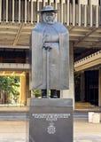 Vader Damien Statue stock afbeeldingen