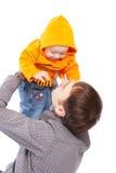 Vader die op baby werpt Stock Afbeelding