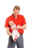 Vader die zijn zoon in handen houden Stock Foto's