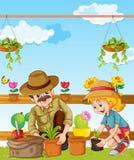 Vader en dochter die in de tuin planten Royalty-vrije Stock Foto's