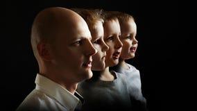 Vader en zonen, het concept genetica en erfelijkheid royalty-vrije stock fotografie