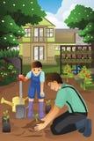 Vader en zoon die in de tuin samen planten Stock Afbeeldingen
